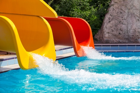 red and yellow slides in a water park