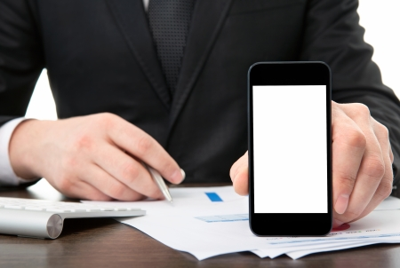 businessman at the office holding a touch phone with isolated screen  photo