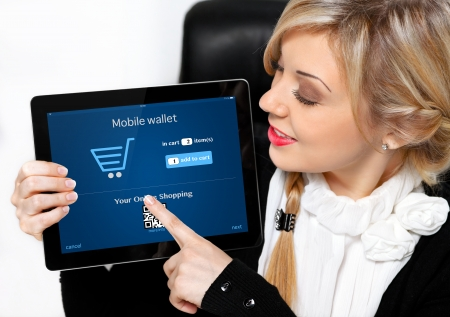 businesswoman holding a tablet with mobile wallet onlain shopping on the screen photo