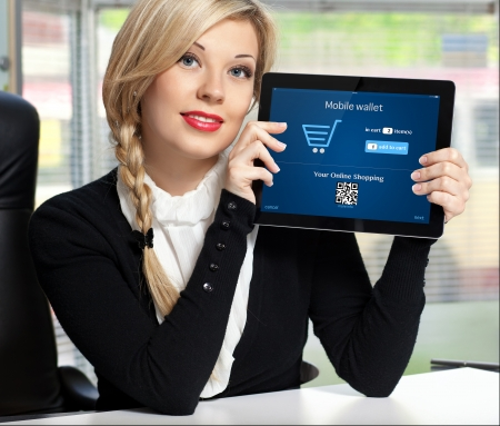 businesswoman holding a tablet with mobile wallet onlain shopping on the screen Stock Photo - 23837706