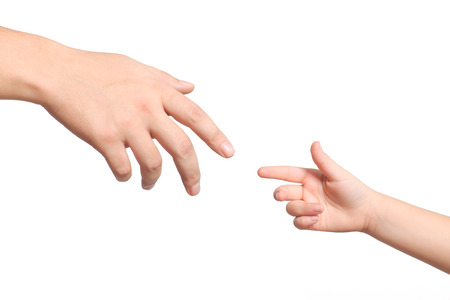keep in touch: isolated men and children hands reach toward each other Stock Photo