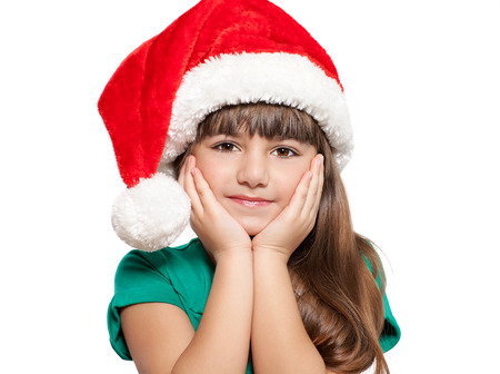 Isolated portrait of a little girl in a Christmas hat  photo