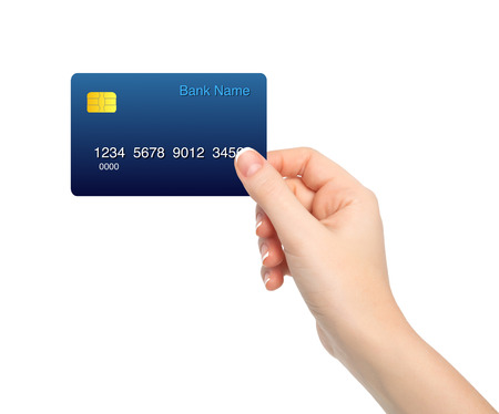 holding credit card: isolated female hand holding a credit card