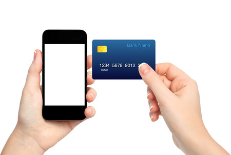 female hands holding phone and credit card on isolated background photo