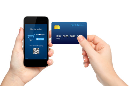 card making: female hands holding phone and credit card making a purchase onlain  Stock Photo