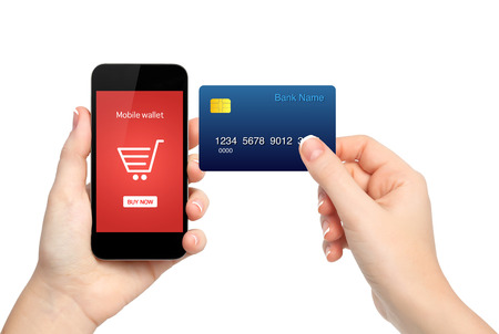 card making: female hands holding phone and credit card making a