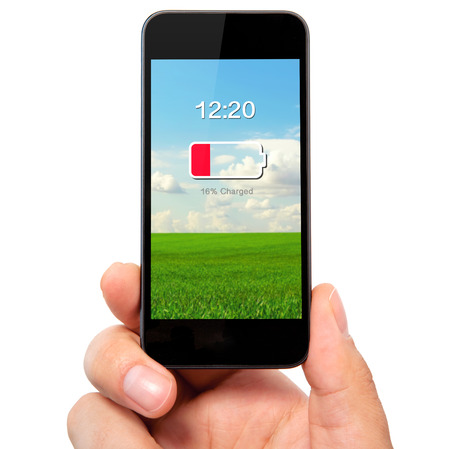 electric cell: isolated man hand holding the phone with low battery on a screen