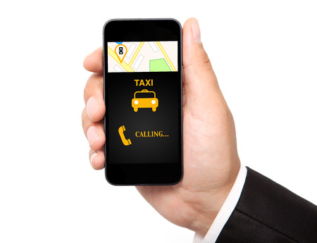 a yellow taxi: isolated man hand holding the phone with interface taxi