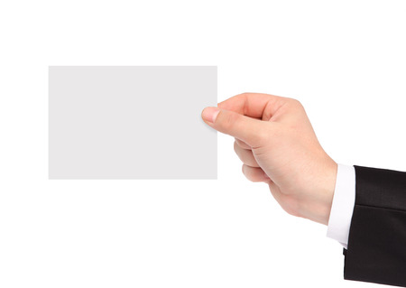 isolated hand of a businessman in a suit holding a piece of paper photo