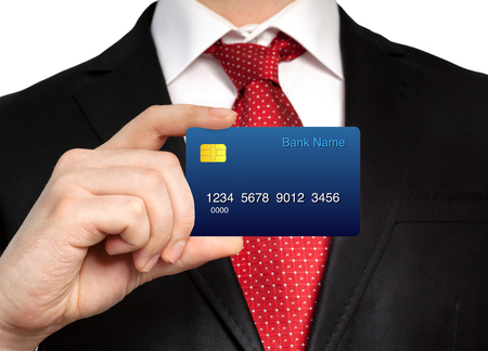 businessman in a suit holding a credit card photo