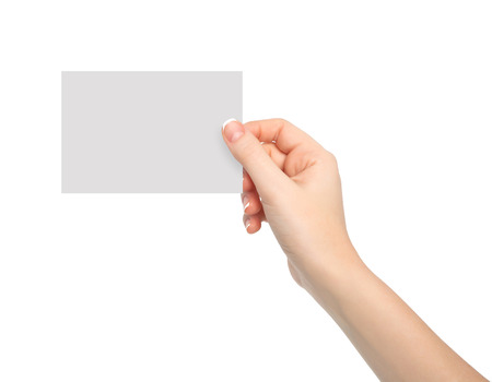 isolated woman hand holding a piece of paper photo