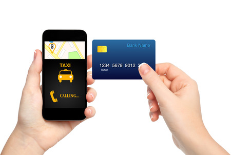 female hands holding phone with interface taxi and credit card on isolated background photo