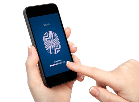 isolated woman hand holding the phone and entering the PIN code of fingerprint  photo