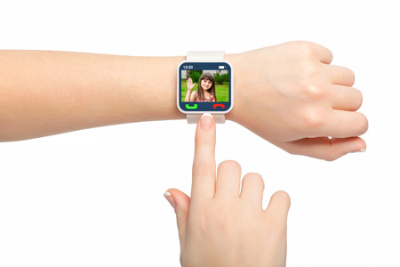 Isolated female hands with white smartwatch with video call on the screen photo