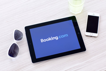 Simferopol, Russia - June 22, 2014  Booking com the system online hotel reservations  Is founded in Amsterdam in 1996