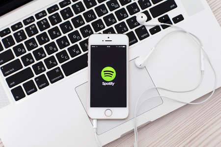 Simferopol, Russia - June 22, 2014  Spotify Swedish music service that offers legal streaming music  Was launched in October 2008  Editorial