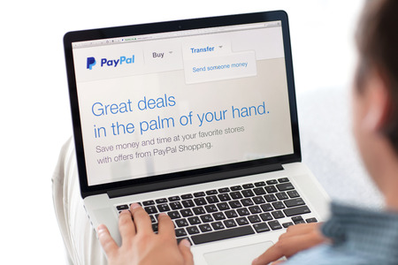 ebay: Simferopol, Russia - July 13, 2014  PayPal the largest operator of electronic money it was founded in 1998  PayPal is the most popular way of reception and sending the Internet of payments at the eBay auction  Editorial