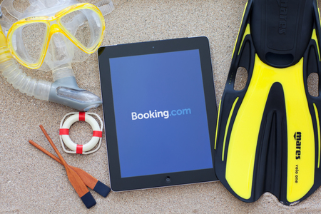 Simferopol, Russia - August 26, 2014: Booking.com the system online hotel reservations. Is founded in Amsterdam in 1996.