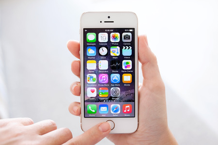 upcoming: Simferopol, Russia - September 19, 2014: Apple iPhone 5S displaying iOS 8 homescreen. iOS 8 mobile operating system designed by Apple Inc. is an upcoming September 17, 2014.