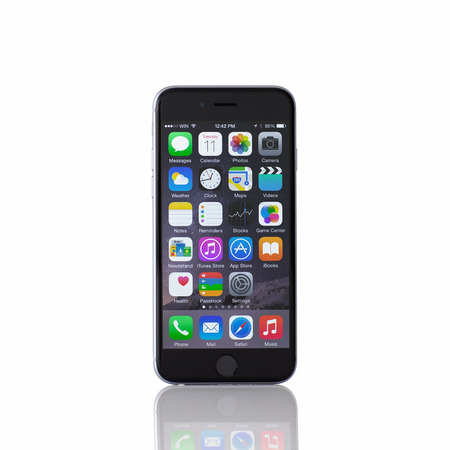 Alushta, Russia - November 11, 2014: Isolated new phone iPhone 6 Space Gray. iPhone 6 was created and developed by the Apple inc.