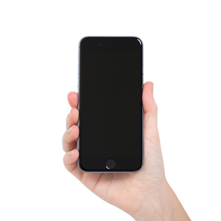 developed: Alushta, Russia - November 13, 2014: woman holding in the hand Isolated new phone iPhone 6 Space Gray. iPhone 6 was created and developed by the Apple inc.
