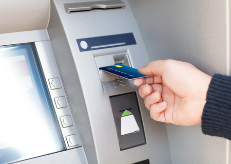 man hand puts credit card into ATM 스톡 콘텐츠