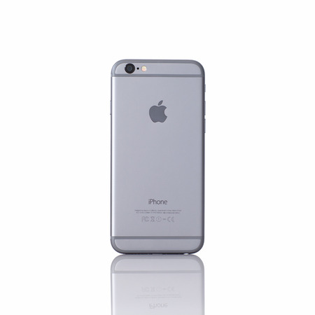 Alushta, Russia - November 11, 2014: New isolated iPhone 6 Space Gray with reflection. iPhone 6 was created and developed by the Apple inc.