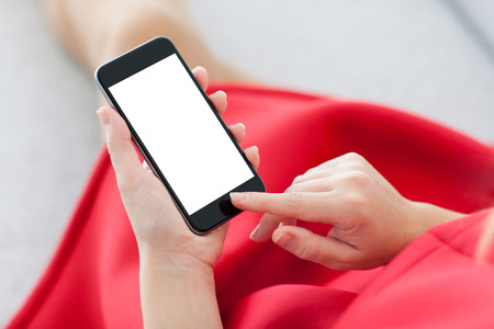 woman in a red dress holding a phone with isolated screen