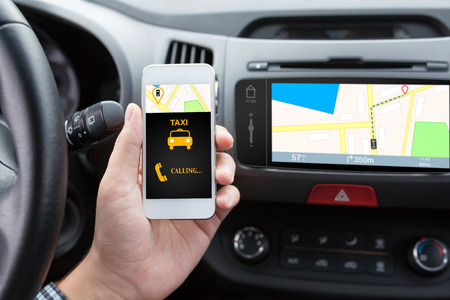 taxi cab: man connecting phone with app taxi in the car and navigation map