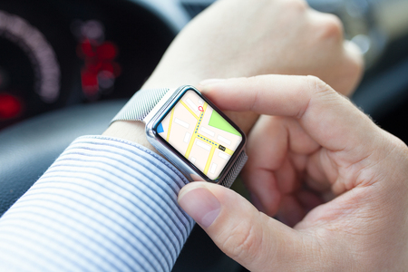 smart: Man hand in the car with watch and app navigation on the screen Stock Photo