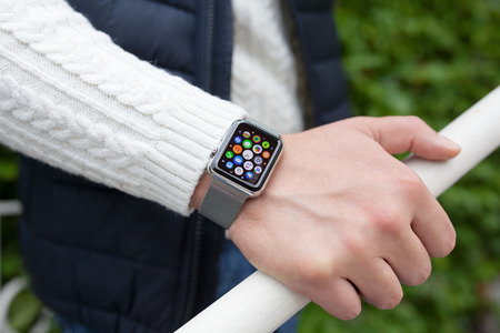 Alushta, Russia - October 14, 2015: Man hand and Apple Watch with app in the screen. Apple Watch was created and developed by the Apple inc. Sajtókép