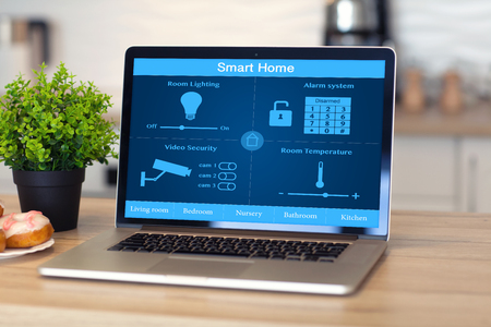 building security: laptop with smart home on the screen is on the table in the room