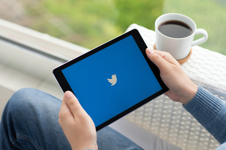 social networking service: Alushta, Russia - June 5, 2016: Man holding a iPad Pro Space Gray with social networking service Twitter on the screen. iPad Pro was created and developed by the Apple inc.
