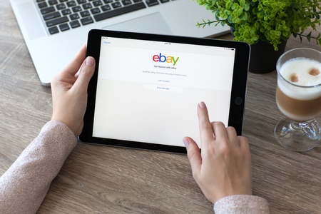 ebay: Alushta, Russia - October 9, 2016: Woman holding a iPad Pro with Internet shopping service eBay on the screen. iPad Pro was created and developed by the Apple inc.