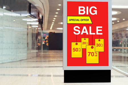 billboard advertising is big discount and sale in a large store