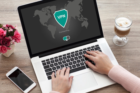 protocols: woman holding notebook with app vpn creation Internet protocols for protection private network