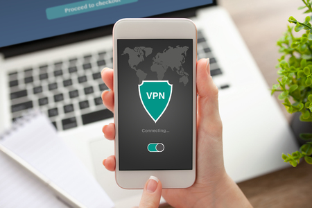protocols: woman holding phone with app vpn creation Internet protocols for protection private network