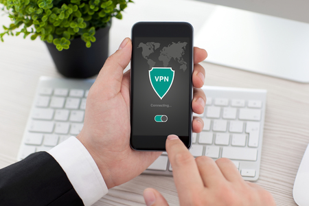 protocols: man holding phone with app vpn creation Internet protocols for protection private network