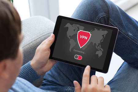 private security: man holding tablet with app vpn creation Internet protocols for protection private network