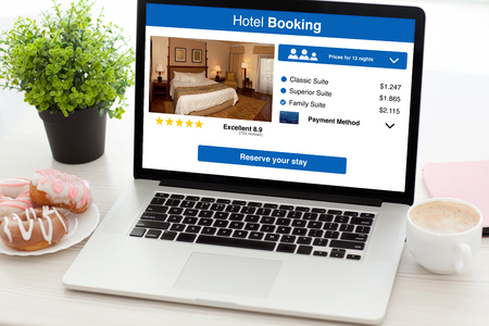 notebook with app hotel booking screen on desk in office