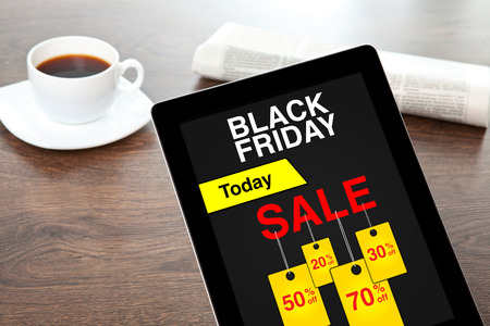 computer tablet with sale black friday screen on table in office Фото со стока