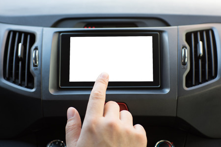 male hand touching a multimedia system with an isolated screen in car Фото со стока