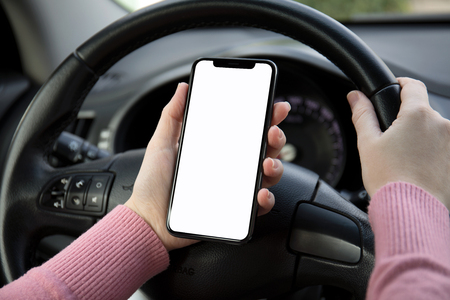 women hands holding phone with isolated screen in the car Фото со стока