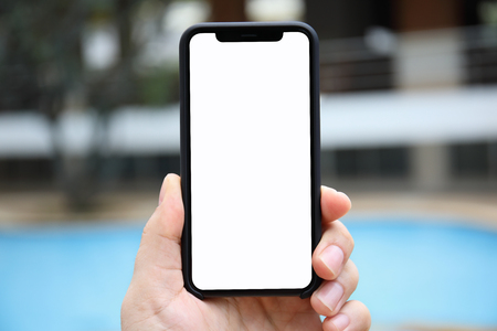 man hand holding phone isolated screen on the background of the pool Stock Photo