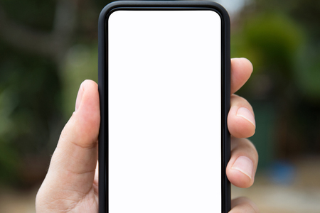 man hand holding phone with isolated screen on the background of nature