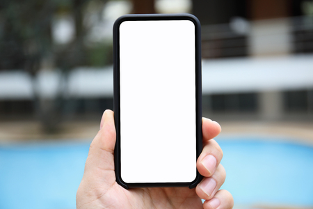 man hand holding phone isolated screen on the background of the pool Фото со стока