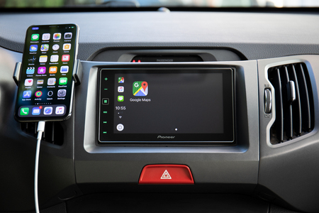 Alushta, Russia - September 19, 2018: Car Play on the multimedia system with Google Maps on the screen. Apple Car Play was created and developed by the Apple inc.
