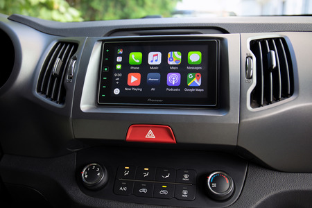 Alushta, Russia - September 20, 2018: Car Play on the multimedia system with Google Maps on the screen. Apple Car Play was created and developed by the Apple inc. Редакционное