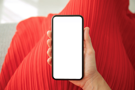 female hands in red dress holding phone with isolated screen