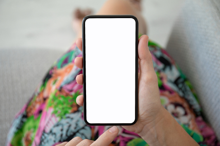 women hands in colored dress holding phone with isolated screen